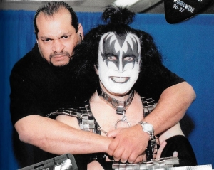 Andre Augustine with Kiss' Gene Simmons (Simmons is on the right)